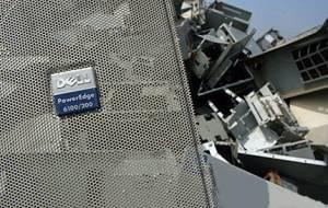 -Elektronický odpad firmy Dell na čínské skládce/ Foto Greenpeace/Natalie Behring-