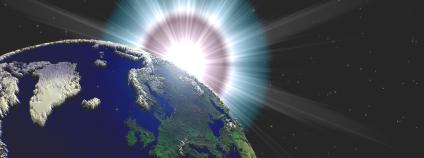 Ilustrační obrázek, slunce nad Zemí. Foto: Circotasu Dreamstime/Free Photo